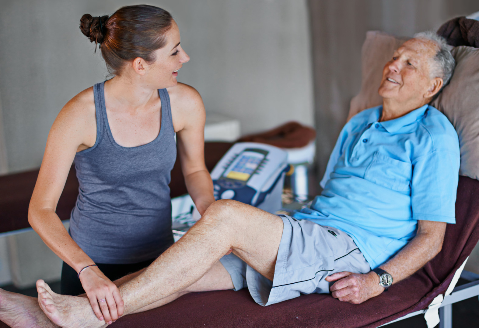 Physical therapist performing manual physical therapy